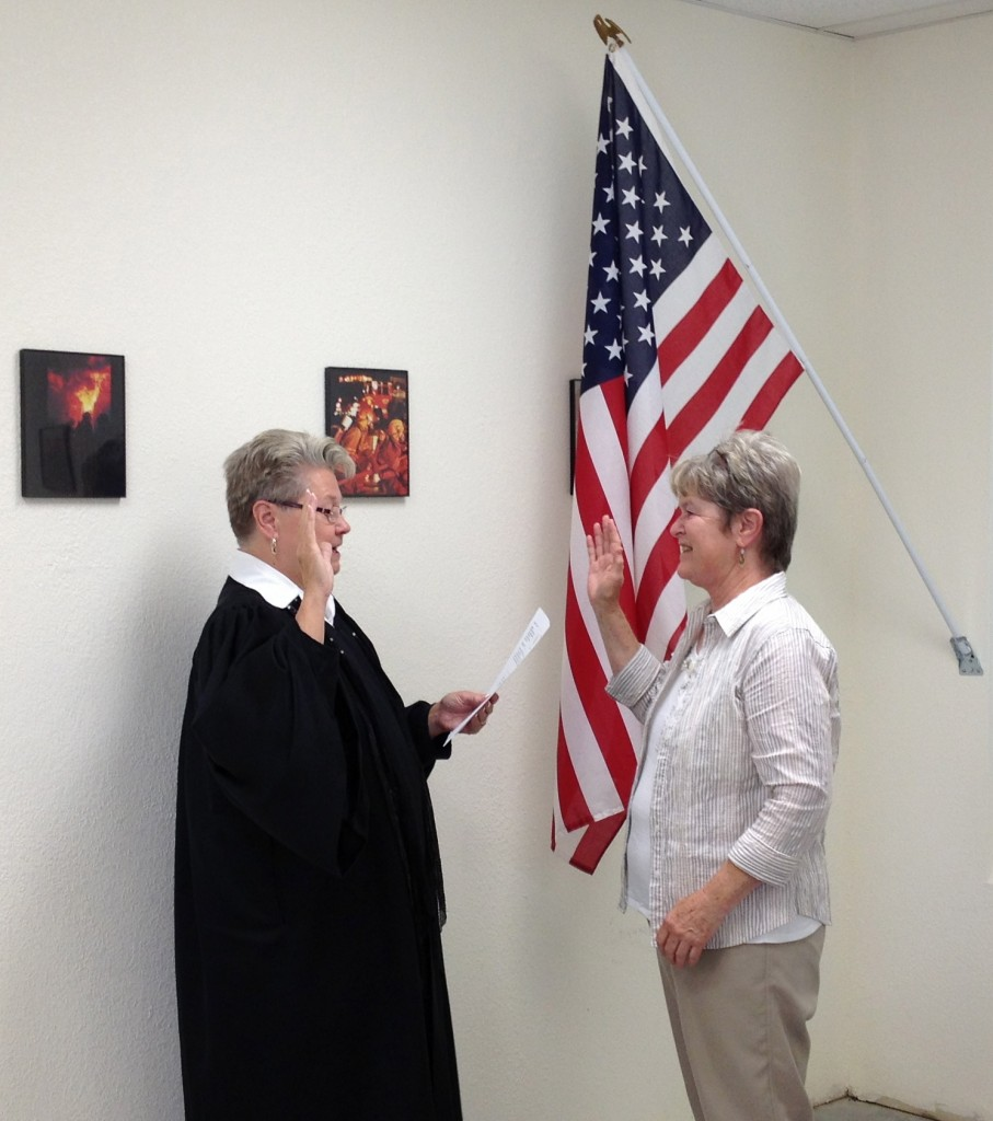 Susan also serves on the new Coupland City Council. Here she is taking her oath of office.