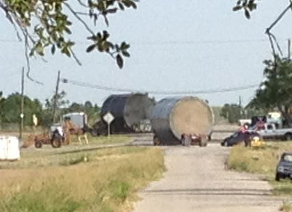 Sorry for the fuzzy shot but I was at the other end of the street and had to zoom in. Here are two of the tanks on flatbed trailers. Two others had just passed through prior to this shot.