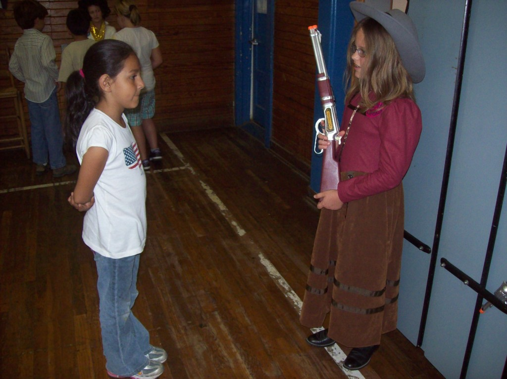 "Coupland student listens to ""Annie Oakley"" during Mrs. Ferguson's Living History Museum."