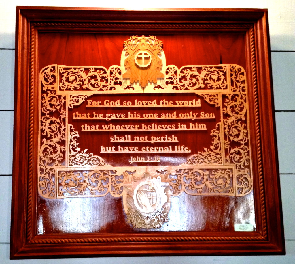 One of several hand-carved plaques in the sanctuary, made by John W. Thompson of Taylor, Texas.