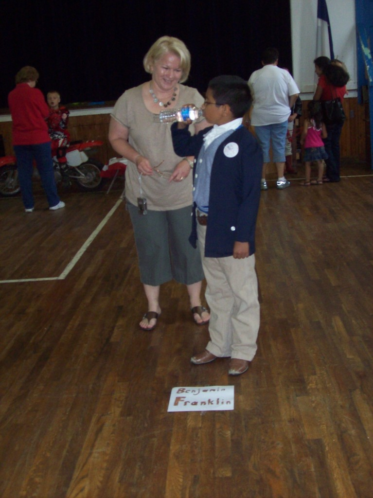 "Mrs. Ferguson speaks with ""Benjamin Franklin"" at a past Living History Museum."